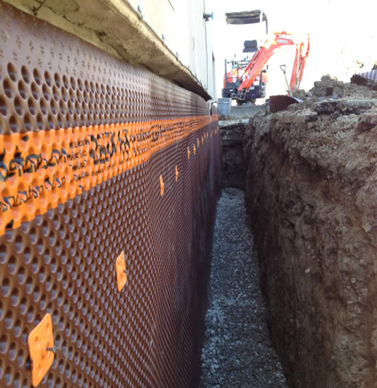 Excavator Next to Waterproofed Wall