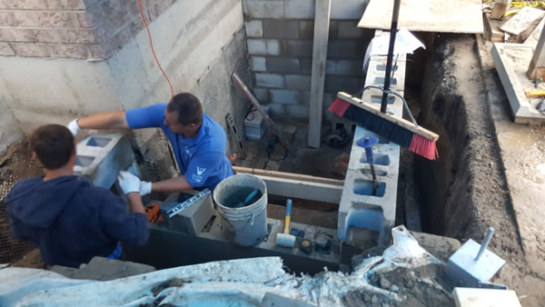 waterproofing techs fixing wall