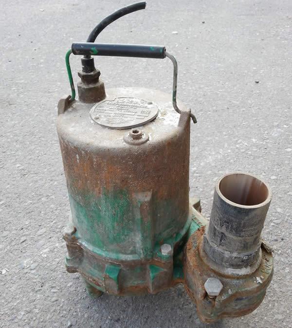 old metal sump pump