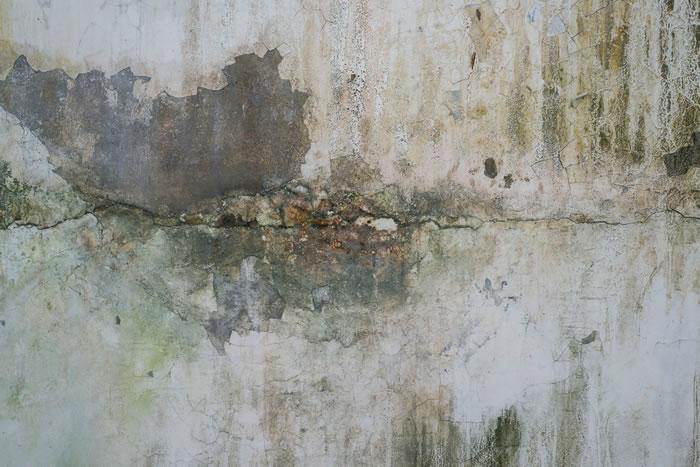 cracked discoloured concrete